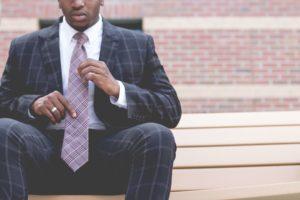Business Man Sitting With Tie - Speak Website
