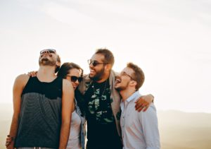 A group of friends laughing and embracing