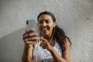 Girl taking a video on her smart phone